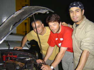 Tim checks the oil on the ferry watched by Boussad and Hakim