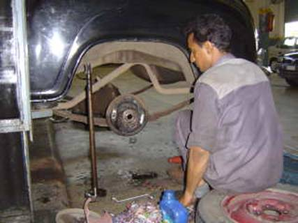Sudesh at ACT India removes the half shaft to repair a gasket